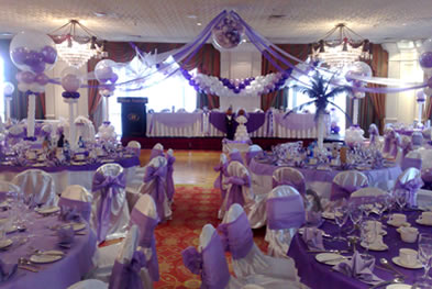 Wedding decorations in essex wedding decor london create a sense of simple elegance with decor elements balloon swags for the top table backdrop floor standing balloon columns exploding balloons above junglespirit Image collections